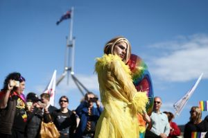 Supporter of marriage equality, Beau Kirq on the front lawn of Parliament House in Canberra on Monday 14 August 2017. ...