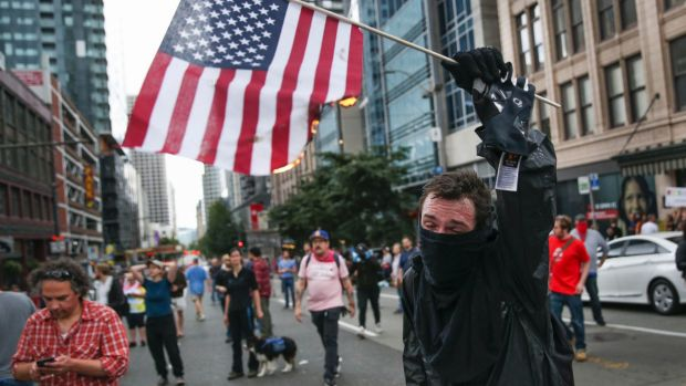 An anti-Trump protester in Seattle in August.