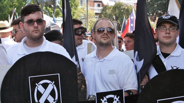 James Alex Fields jnr, left, holds a black shield at the rally in Charlottesville.