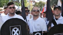 James Alex Fields jnr, second from left, holds a black shield at the rally in Charlottesville.