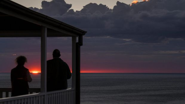 Another day: Renata and Colin Musson watch sunrise from the head lightkeeper's cottage at Wilsons Promontory lighthouse.