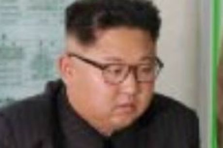Kim Jong-un consults maps of proposed missile launches to Guam, in this image published by North Korean state media.