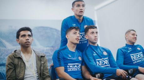 Gamer Marcus Gomes (left) with Melbourne City players Daniel Arzani, Ramy Najarrine and Dylan Pierias