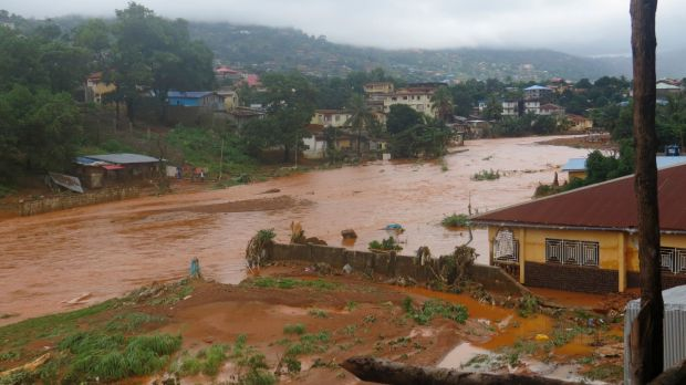 A torrent of water flows through a flooded neighbourhood in Regent, east of Freetown, Sierra Leone, in August.