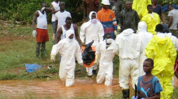 Rescue workers carry the body of a victim from the site of a mudslide in Regent, east of Freetown, Sierra Leone on Monday.