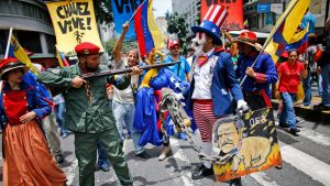 Government supporters perform a parody involving a Venezuelan militia up against Uncle Sam, a personification of the U.S ...