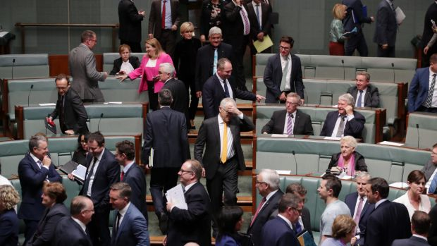 Prime Minister Malcolm Turnbull enters the House after his government lost a division 69-61