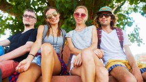 backpackers, travellers, tourists, group of friends in thailand posing for photo. Adobe Stock