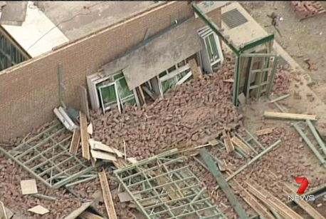 A worker was killed when a wall collapsed during high winds in Carlingford.