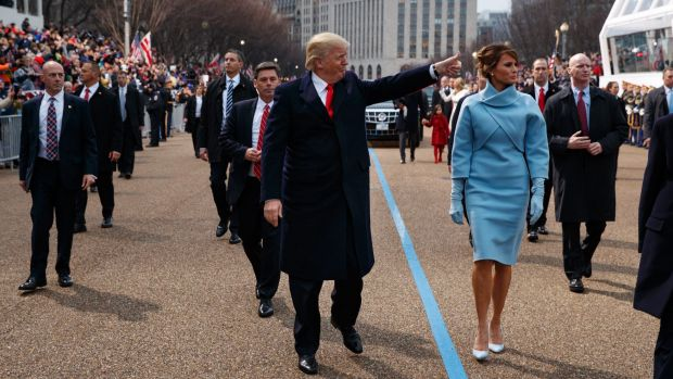 Donald Trump walks with first lady Melania Trump along the inauguration day parade route after being sworn in as the