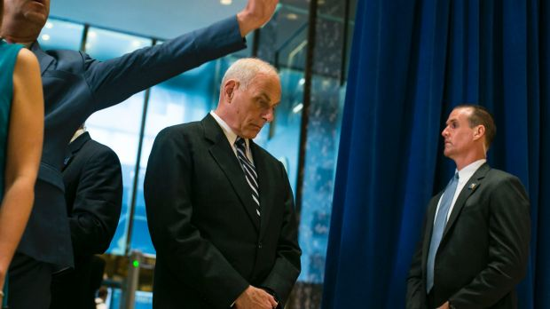 John Kelly, the White House chief of staff, looks down as US President Donald Trump speaks in the lobby of Trump Tower.