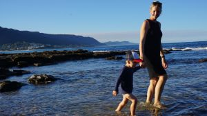Sea change: Amber Joyce and her son Billy on the beach in Thirroul.