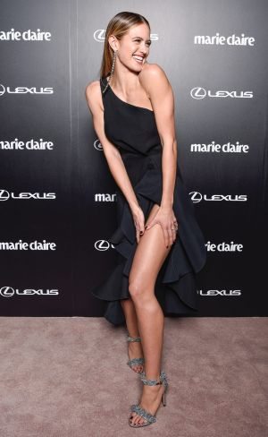 Jesinta Franklin having an Angelina Jolie moment in a black, one-shouldered Dion Lee gown.