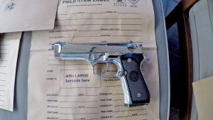 Police seized a loaded semi-automatic handgun during the raid on Wednesday.