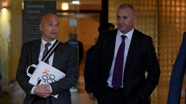 Bug out: Adrian Gard, (right) has pleaded not guilty to making up claims about finding a bug secreted in a chair in an ...