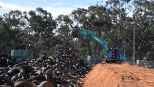 Multiple excavators chip away at removing the stockpile at Stawell Tyre Yard on Wednesday August 16, 2017.?Credit Rex ...
