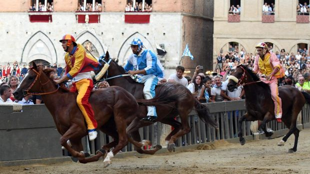 Carlo Sanna, center, also known as 'Brigante' (Bandit) of the district of the Onda (Wave) neighborhood, rides the horse ...