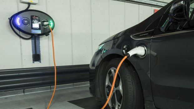 An electric vehicle recharges in London.