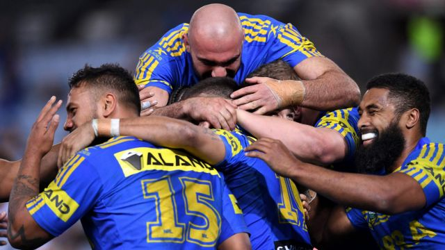 Back to winning ways: Parramatta Eels players celebrate one of their five tries on Thursday.