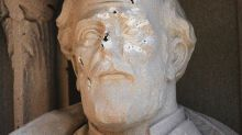A defaced General Robert E. Lee statue stands at the Duke Chapel in Durham, NC.