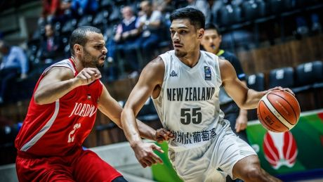 New Zealand's Shea Ili drives against Jordan in their semi final.