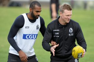 Heritier Lumumba with Nathan Buckley at a Collingwood training session in 2014.