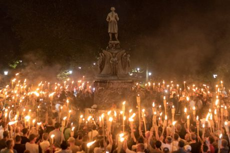 Torch-bearing white nationalists rally around a statue of Thomas Jefferson near the University of Virginia campus in ...