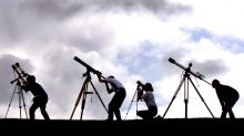 Members of the British Astronomers Association train their telescopes at the sun on August 10, 1999, near Truro in ...