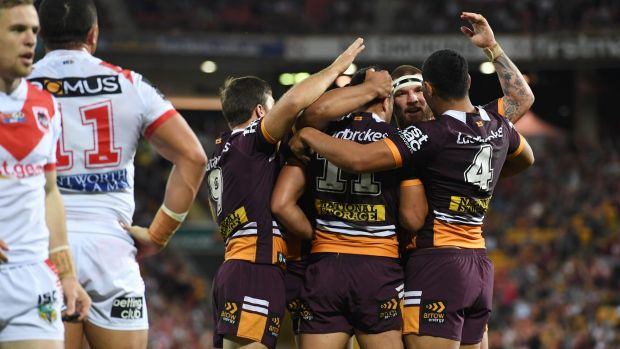 Job done: Brisbane players celebrate after scoring a try.
