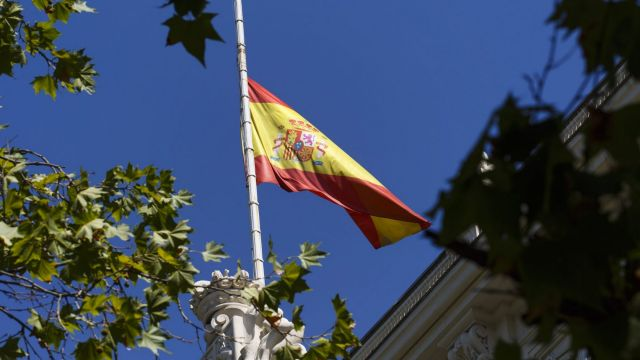 The Spanish flag flies at half staff above the Madrid stock exchange.