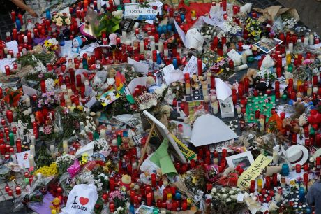 Flowers, messages and candles form a memorial tribute to the victims on Barcelona's historic Las Ramblas promenade.