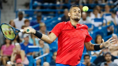 Nick Kyrgios, of Australia, returns to Rafael Nadal, of Spain, at the Western & Southern Open tennis tournament, Friday, ...