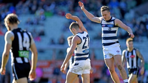 We'll take it: Mitch Duncan and Sam Menegola celebrate the Cats' win.