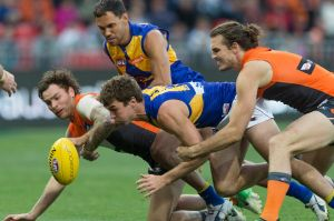 Phil Davis of the Giants tackles Jamie Cripps.