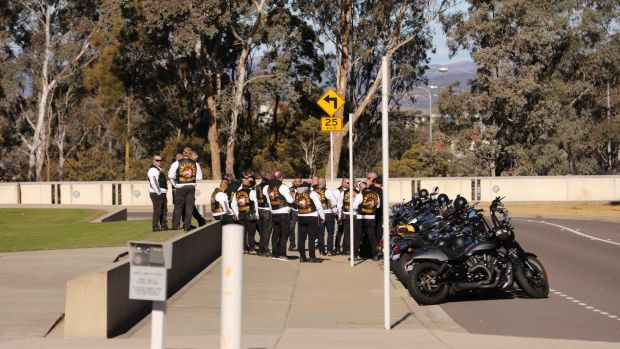 Members of the Comancheros gather outside Parliament House.