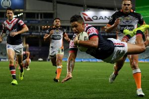 Escape act: Latrell Mitchell scores the match-winner in the 74th minute