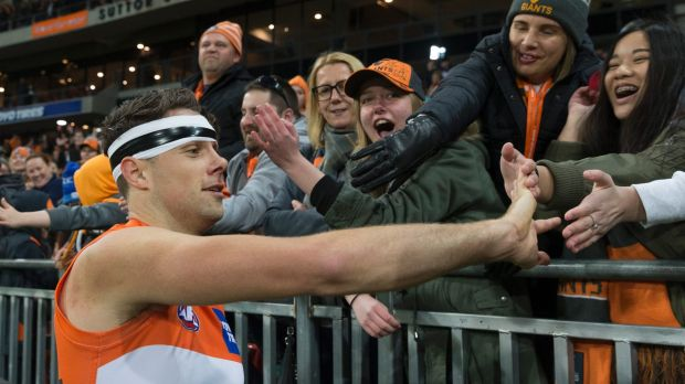 Main man: Josh Kelly enjoys the victory with fans.