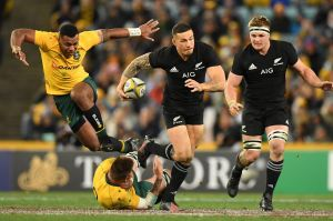 Through the gap: Sonny Bill Williams steps through the tackle of Sean McMahon.