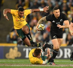 Through the gap: Sonny Bill Williams steps through a tackle by Sean McMahon on a night of leaky defences.