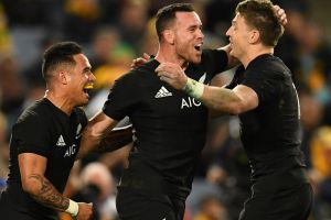 Ryan Crotty (centre) of New Zealand celebrates his try during game 1 of the Bledisloe Cup between the Australian ...