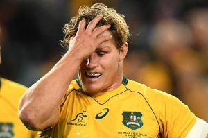 Tough night: Skipper Michael Hooper reacts to another All Blacks try.