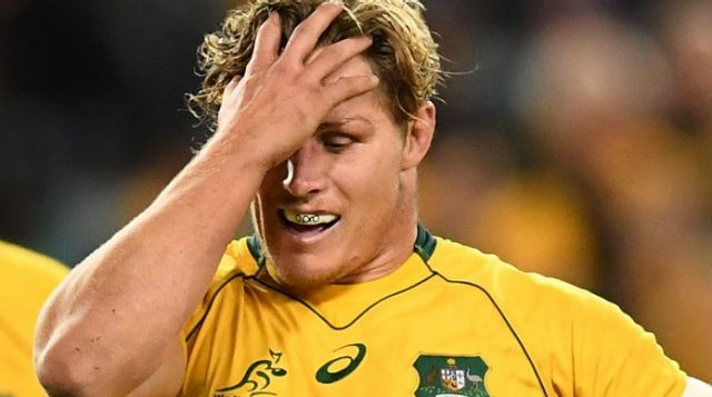 Tough night at the office: Michael Hooper reacts to another All Blacks try.