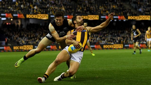Collared: Marc Murphy stops Paul Puopolo, albeit illegally,   on the way to Carlton's first win over Hawthorn since 2005.