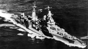 The USS Indianapolis, a 10,000-ton American heavy cruiser, is picture as she appeared steaming along in her war paint. ...