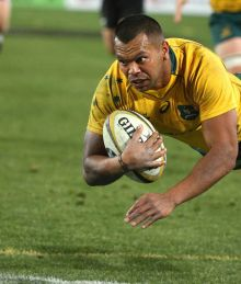 Australia's Australia's Kurtley Beale flies through the air to score a try against New Zealand during their rugby union ...