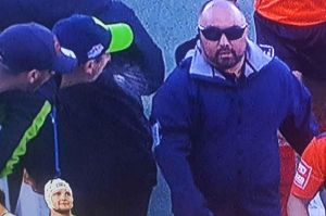 A Raiders fan appears to spit towards the officials at half-time in Sunday's game.