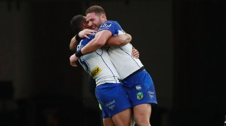 Bounce back: Brenko Lee, right, and Marcelo Montoya hug after a try.
