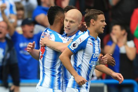 Huddersfield's Australian midfielder Aaron Mooy celebrates with teammates after scoring against Newcastle on Sunday.