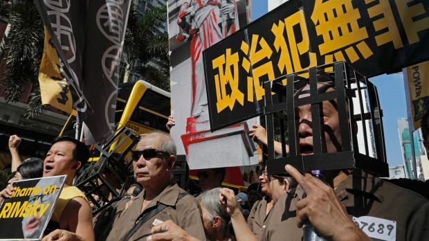 In Hong Kong : Leader defends jailing of activists