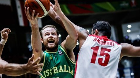 Australia's Brad Newley drives to the basket in the gold medal game.